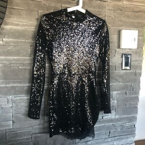 Dresses & Skirts - Black sequinned mini dress with lace details
